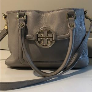 Tory Burch gray leather handbag with gold accents.
